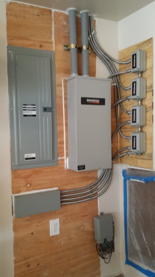 This project needed to upgrade the electrical panel in order to install the generator.  These folks both work from home, so when the power goes out, now they only have to wait a few seconds and they are back on line.  The power management modules allowed a smaller generator to manage this all electric house.