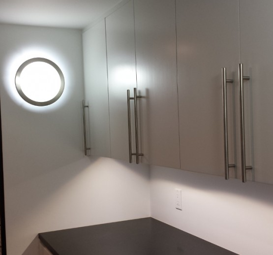 This customer found this LED wall sconce for the laundry room.  Also has LED under cabinet lighting for the folding counter.